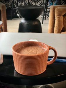 A mug on a table at Nest Cafe, one of the best cups of hot chocolate in Denver